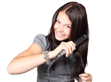girl using flat iron