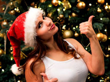 girl in santa hat giving thumbs up